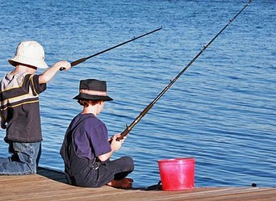 Kids fishing off a dock
