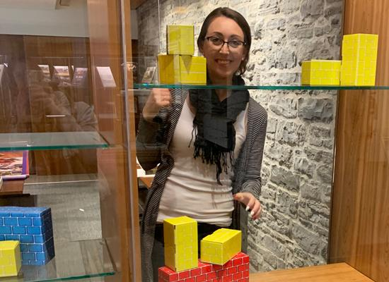 Lady putting blocks in a display