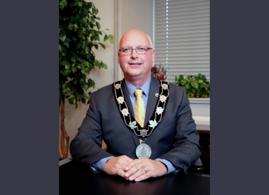 Warden Bresee wearing Chain of Office